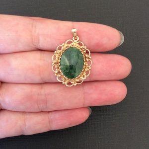 Jewelry - Vintage 14KT yellow gold jade pendant .